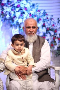 Aurangzeb Khan with his grandson